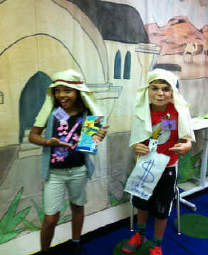 Children acting out the Pharisee and Tax Collector Bible story